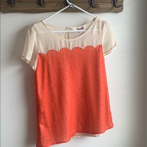Semi sheer orange shell with lace detailing